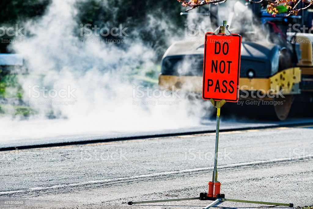 DO NOT PASS road sign in construction zone stock photo