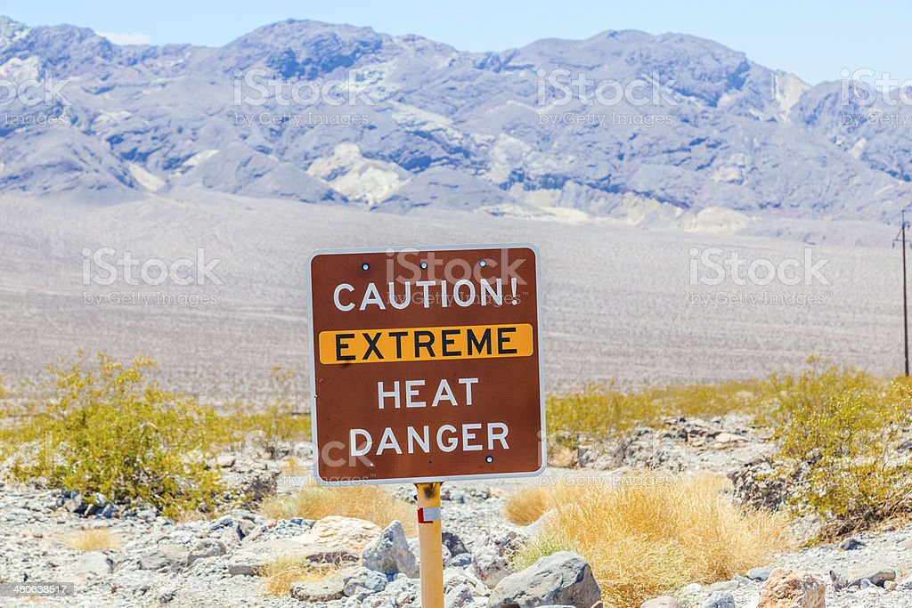 road sign in Death Valley warning travelers of extreme heat stock photo