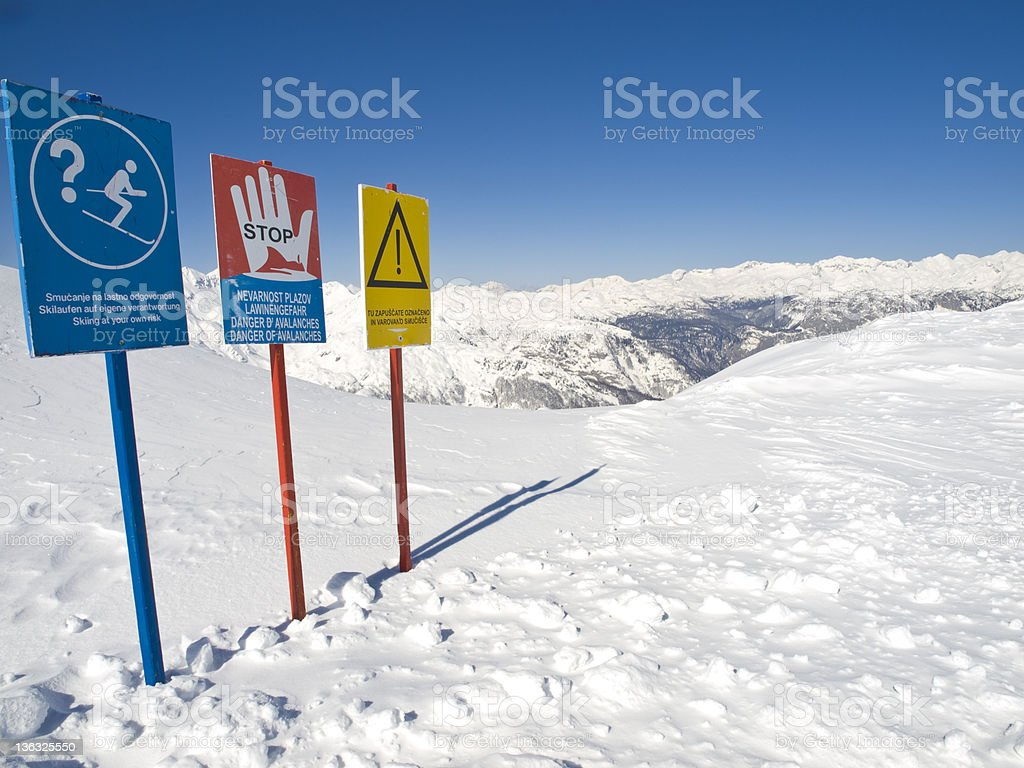 Road sign in winter mountains stock photo