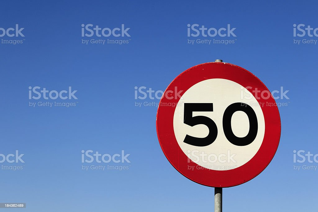 road sign indicating a maximum speed of 50 royalty-free stock photo