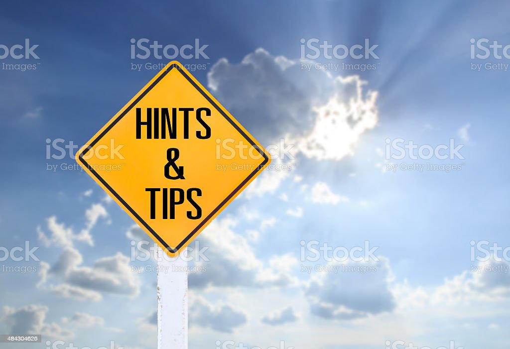 Road sign indicating Hints and Tips on blurred sky background stock photo