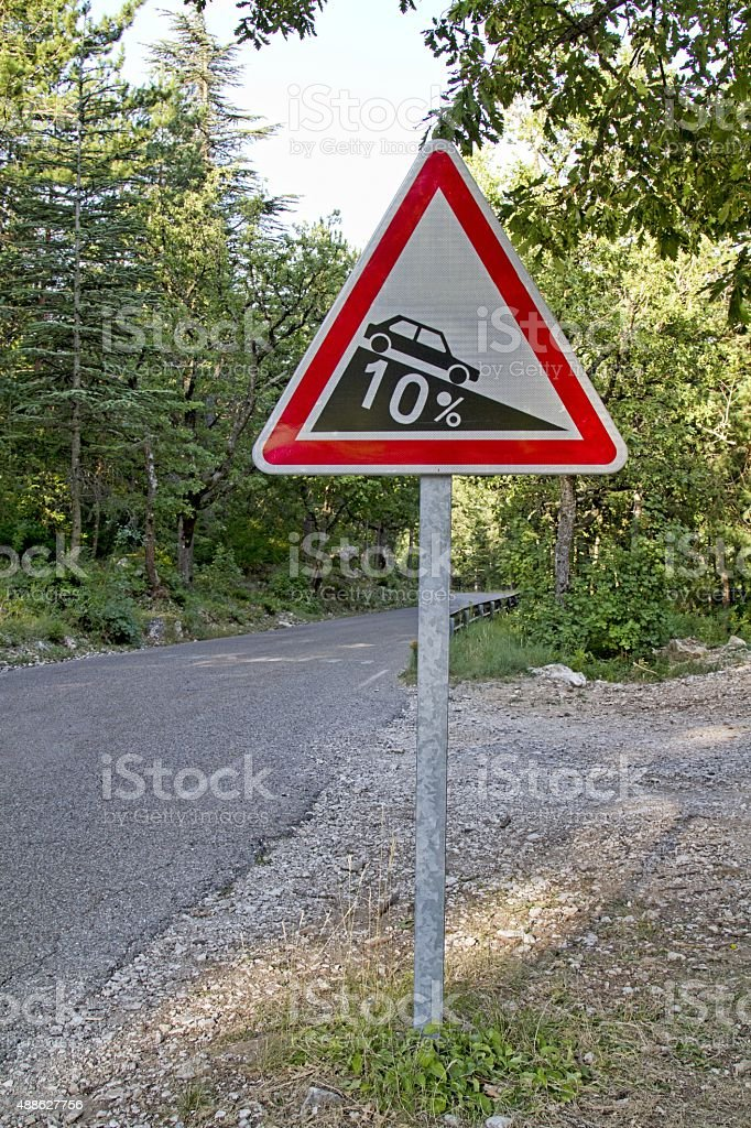 Road sign indicating steep slope stock photo