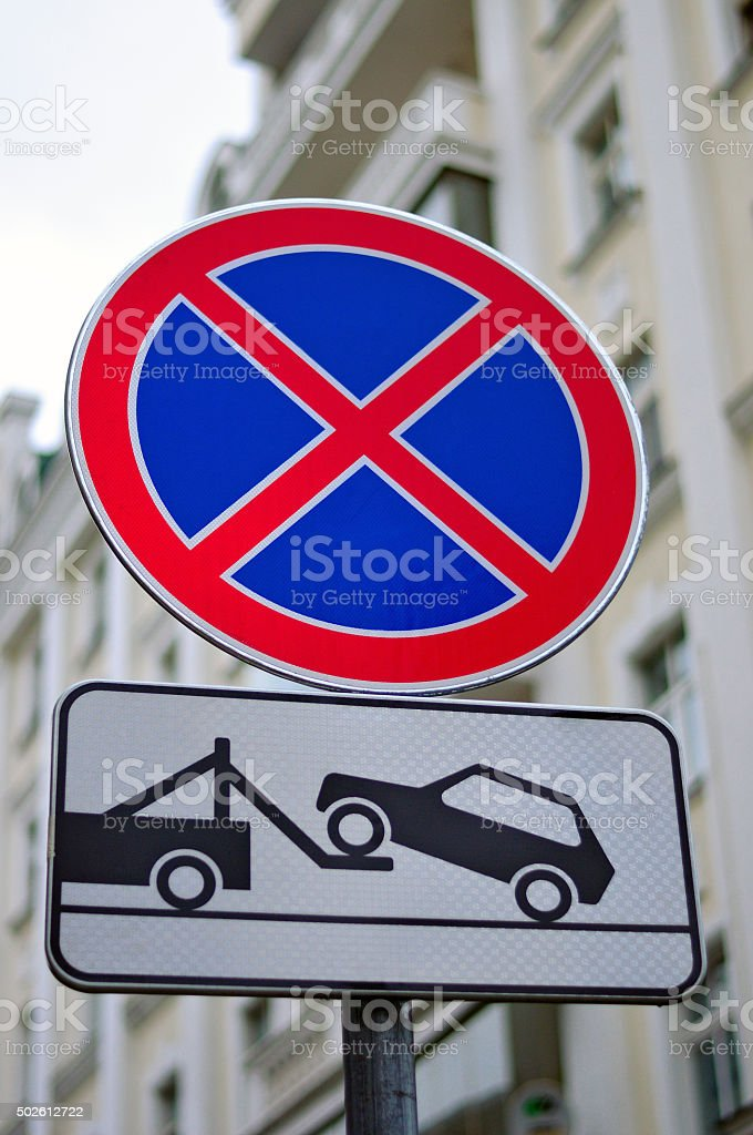 Road sign No stopping and parking and evacuation of cars stock photo