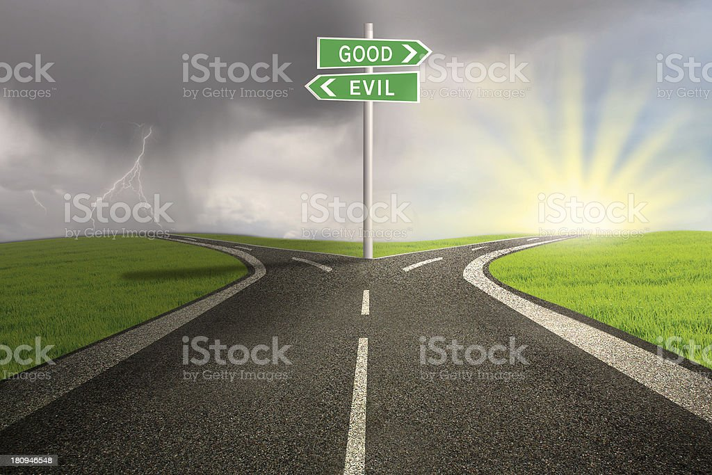 Road sign of good vs evil stock photo