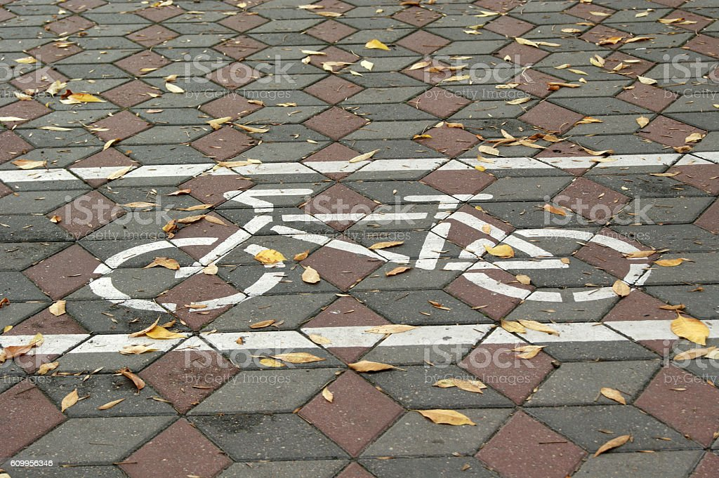 Road sign on asphalt for the ride cyclists and fallen stock photo