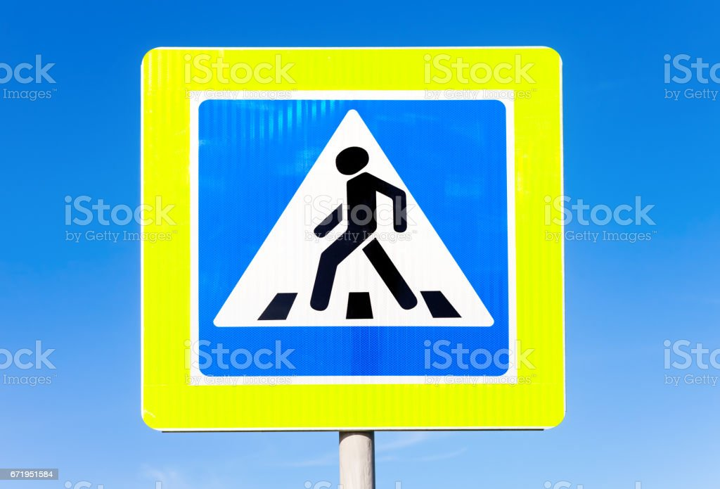 Road sign Pedestrian crossing against the blue sky background stock photo