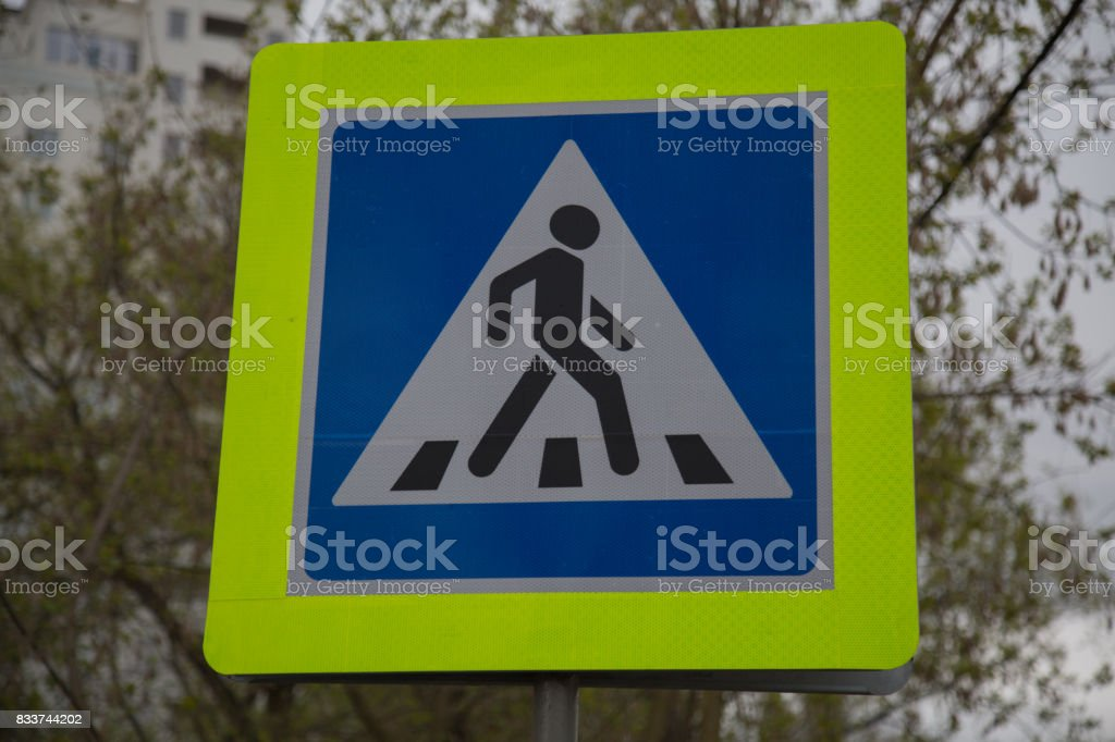 Road sign pedestrian crossing Russia blue yellow background stock photo