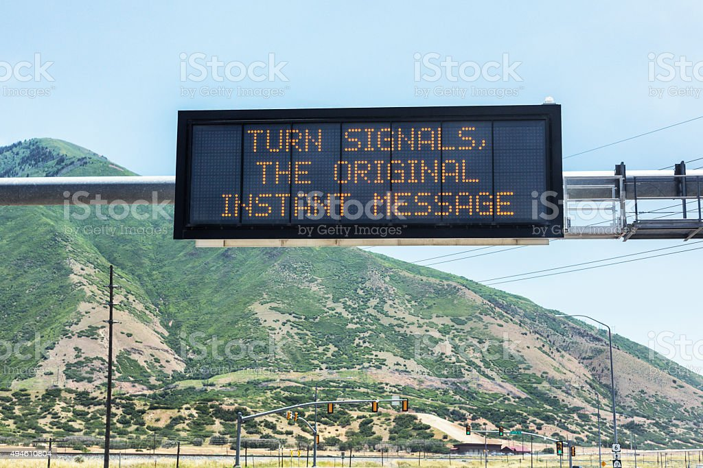 TURN SIGNALS, THE ORIGINAL INSTANT MESSAGE Road Sign stock photo
