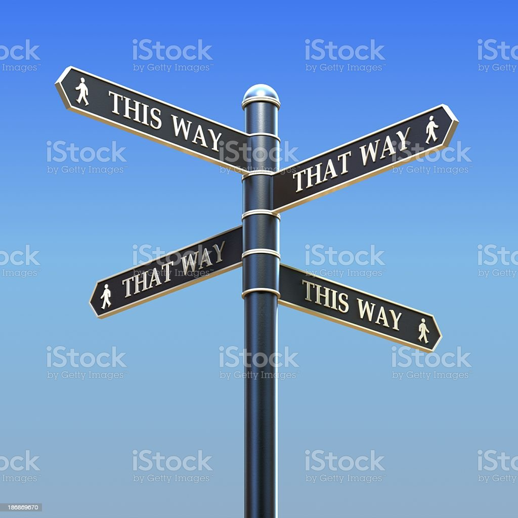 Road sign pointing in four different ambiguous directions stock photo