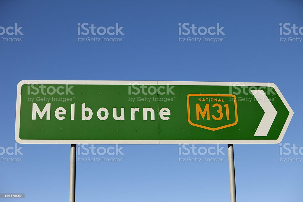 Road sign points to the right towards Melbourne royalty-free stock photo