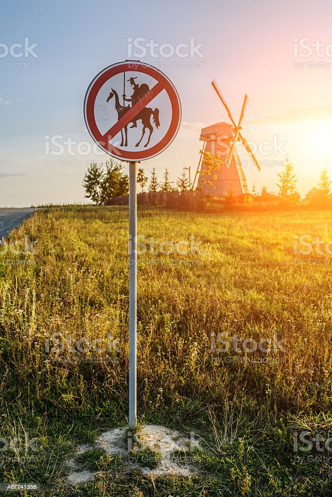 Road sign prohibits Don Quixote stock photo