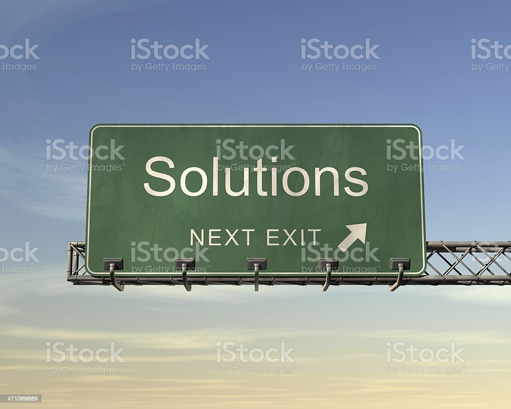 Road sign saying solutions in front of blue sky royalty-free stock photo