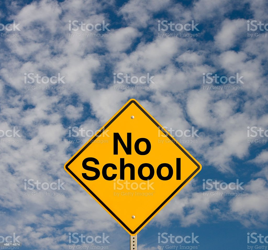 A road sign showing no school with a cloud filled sky stock photo