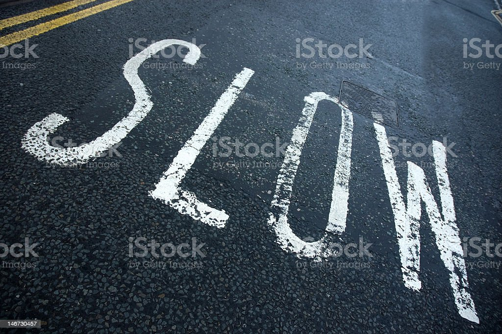 road sign slow stock photo