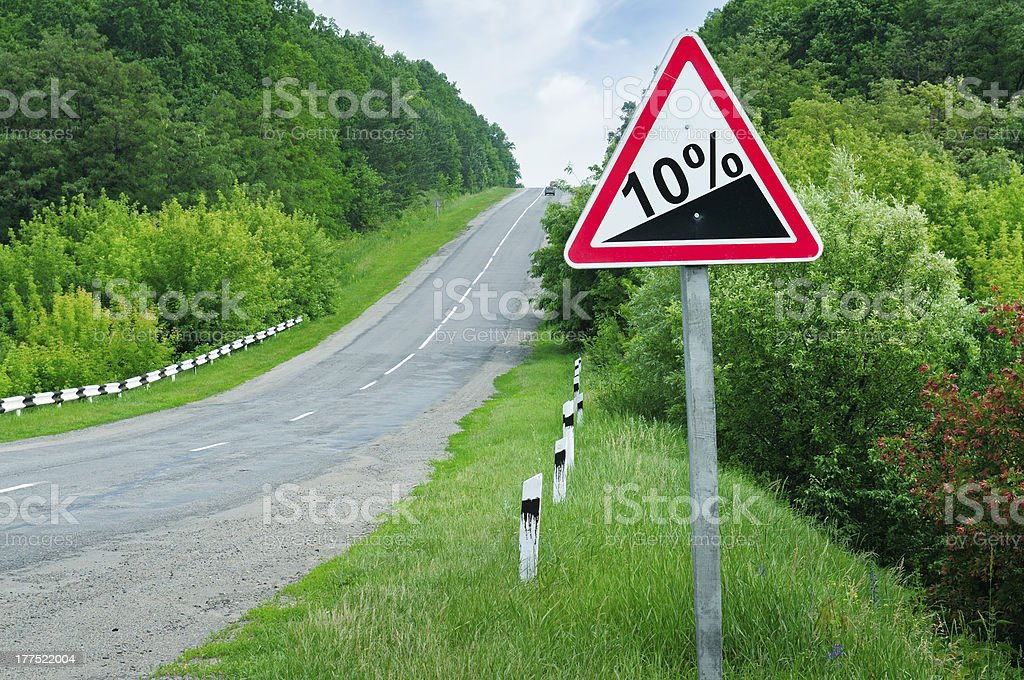 road sign steep slope stock photo