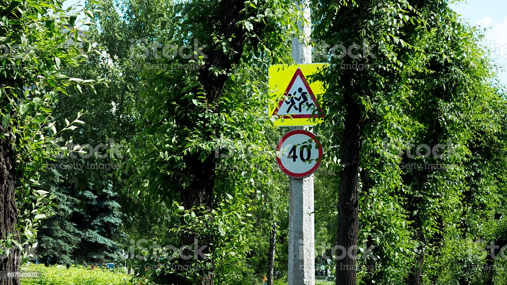 road sign steep slope warm summer day in the city stock photo