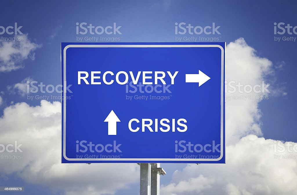 Road Sign The End Of Crisis, Economic Recovery stock photo