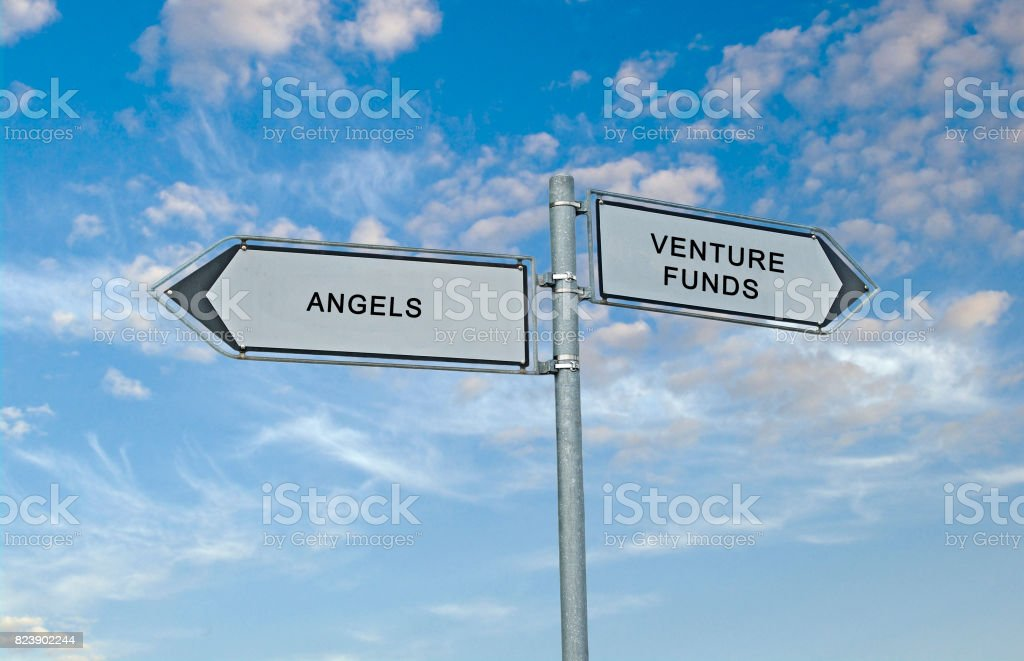 Road Sign to angels and venture funds stock photo