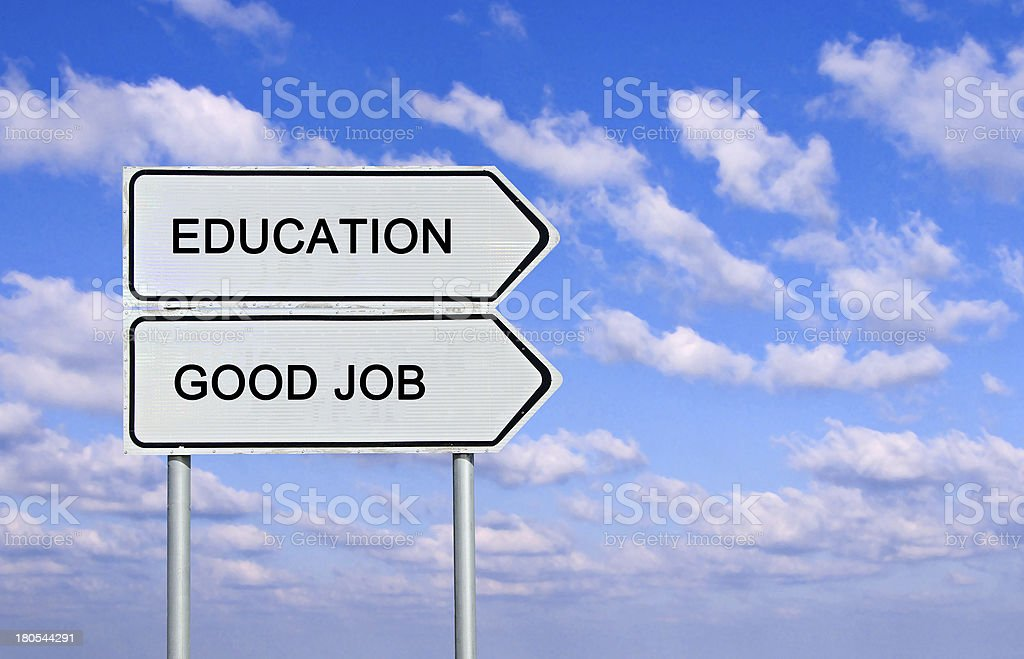 Road sign to  education and good job stock photo