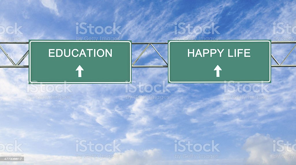 Road sign to  education and happy life stock photo