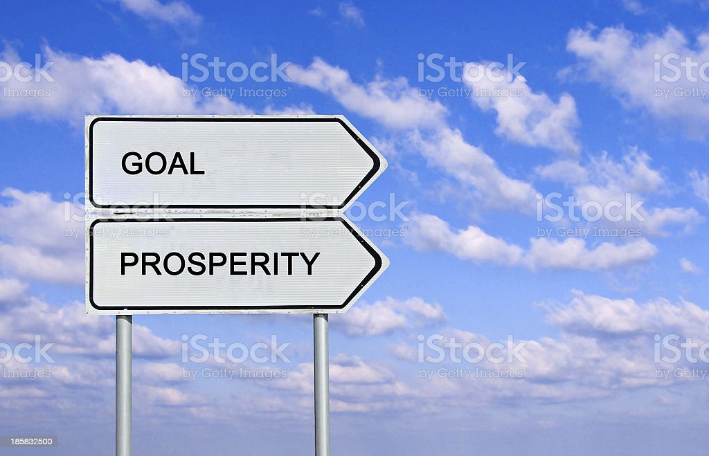Road sign to goal and prosperety stock photo