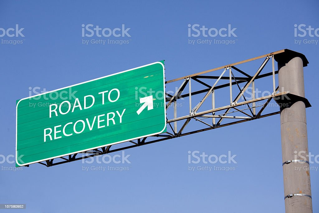 Road sign to recovery stock photo