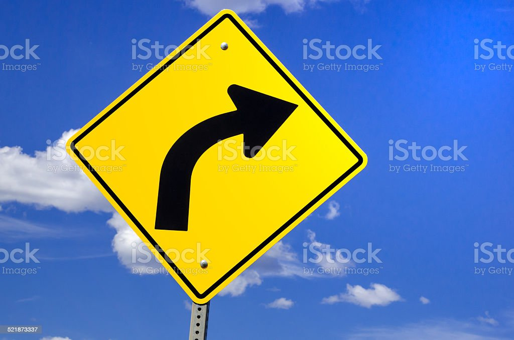 Road Sign Warning of Dangerous Curve Ahead stock photo