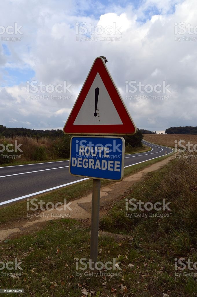 Road sign with an exclamation mark. stock photo