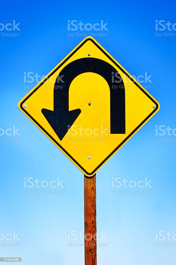 Road Sign with Arrow Pointing to Turning Around stock photo