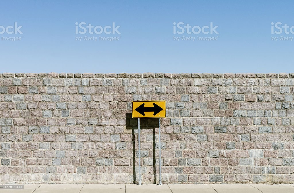 Road sign with double arrows stock photo