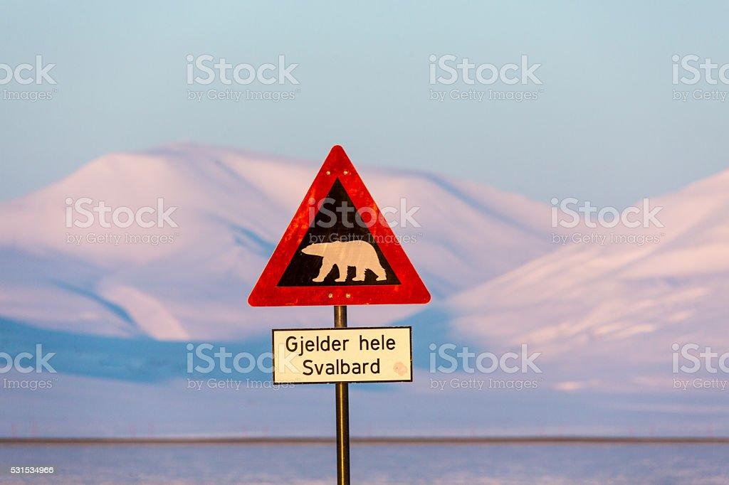 Road sign with Plar bear in Longyearbyen stock photo