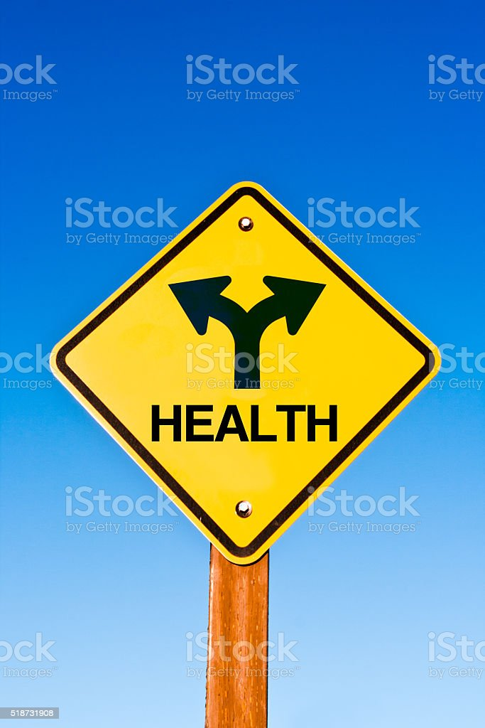 Road Sign with Symbol of Crossroad Intersection of Life Journey stock photo
