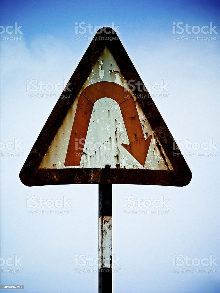 Road signboard showing U turn ahead stock photo