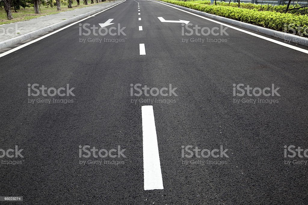 road signs arrows on asphalted surface royalty-free stock photo