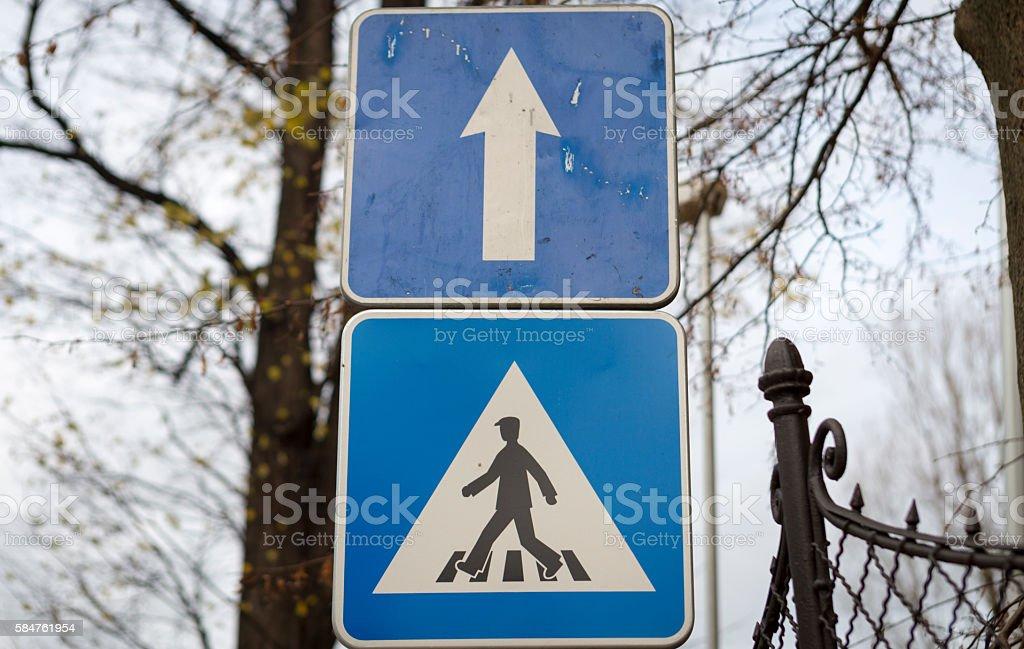 Road signs: pedestrian crossing and straight. Kromeriz, Slovakia. stock photo