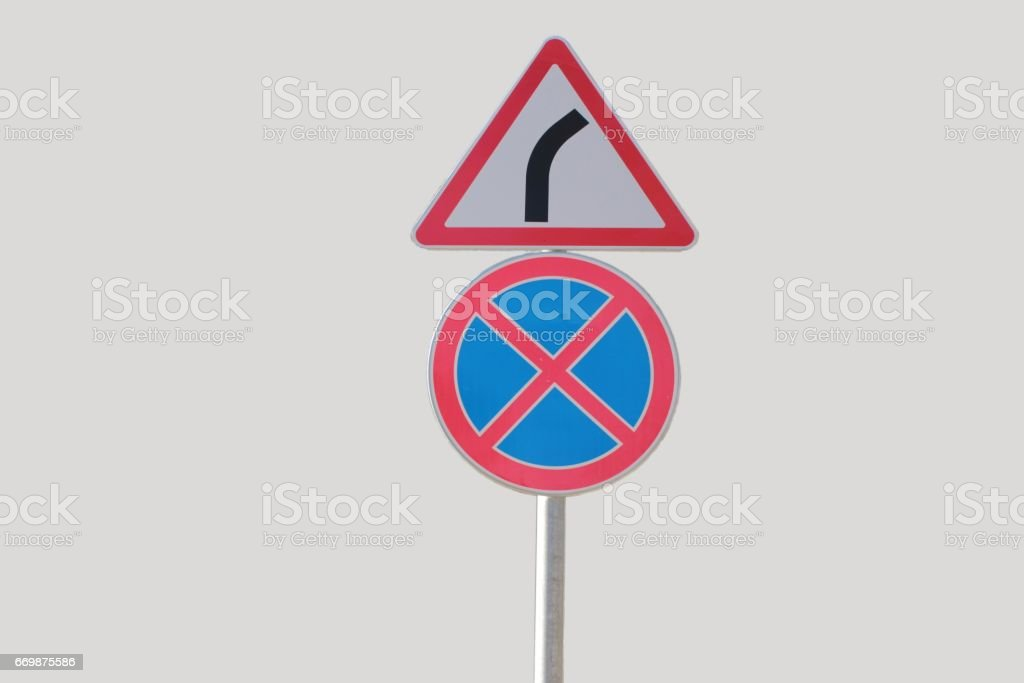 Road signs, stopping and Parking is prohibited and dangerous turn stock photo