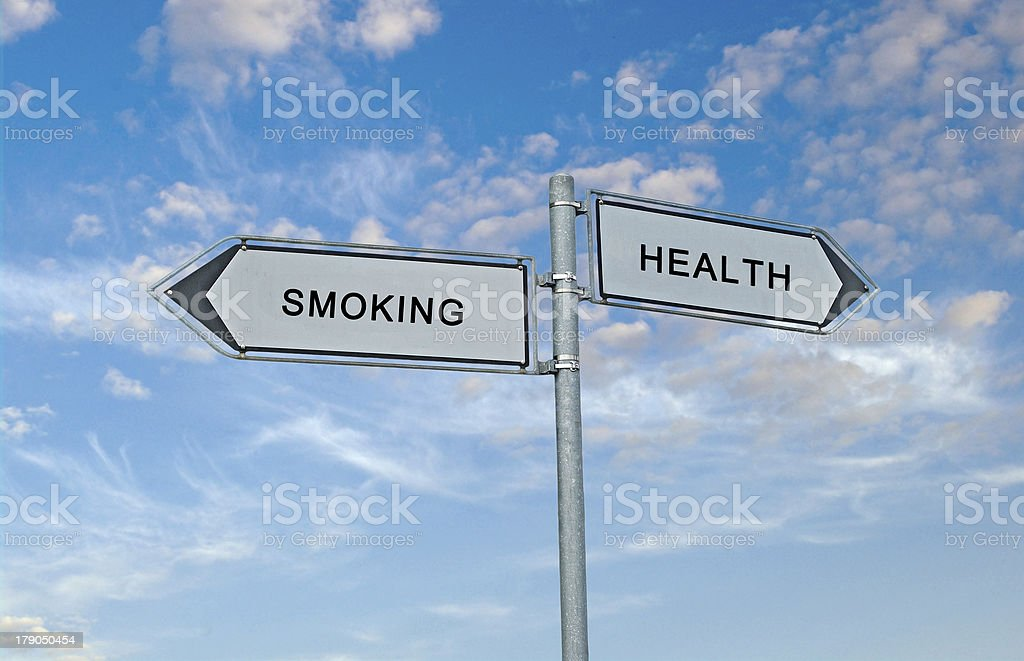 Road signs to smoking and health royalty-free stock photo