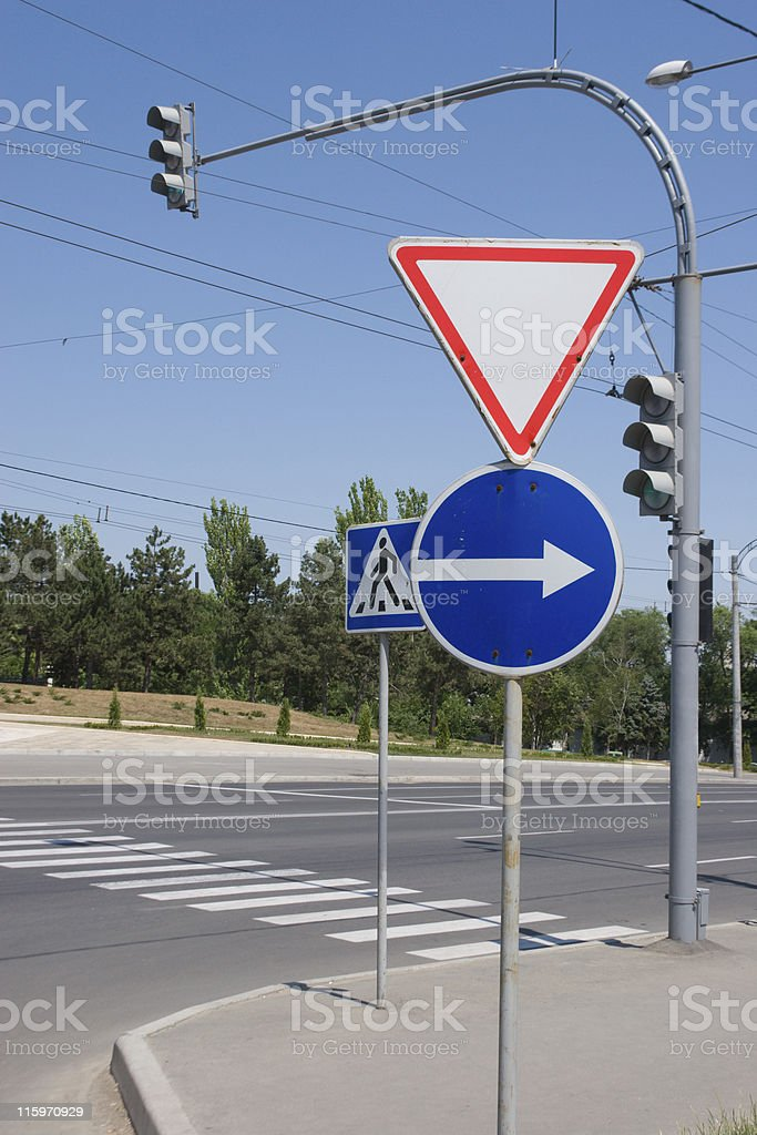 Road signs, traffic lights and pedestrian crossing royalty-free stock photo