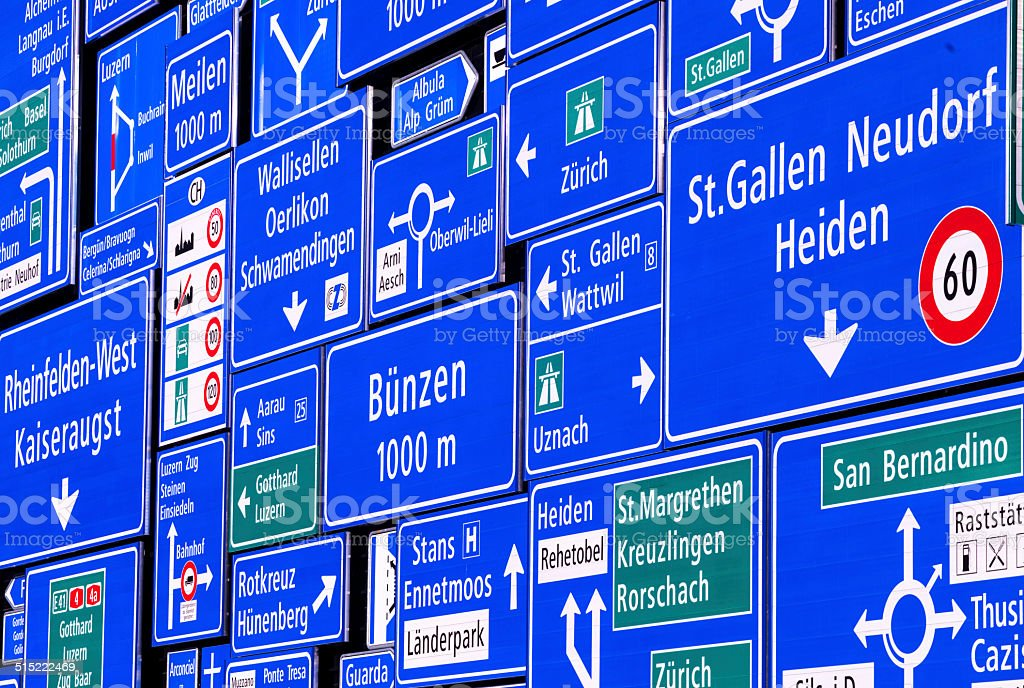 Road signs wall stock photo