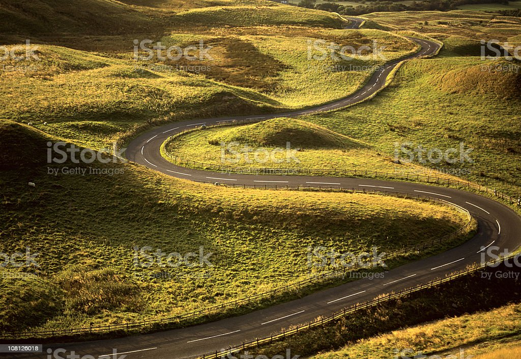 Road Snaking Through Landscape stock photo