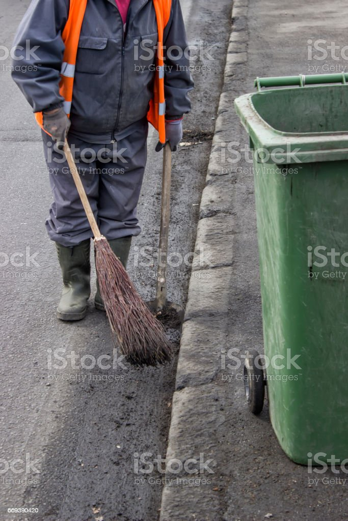 Road sweeper with brown  and shovel stock photo