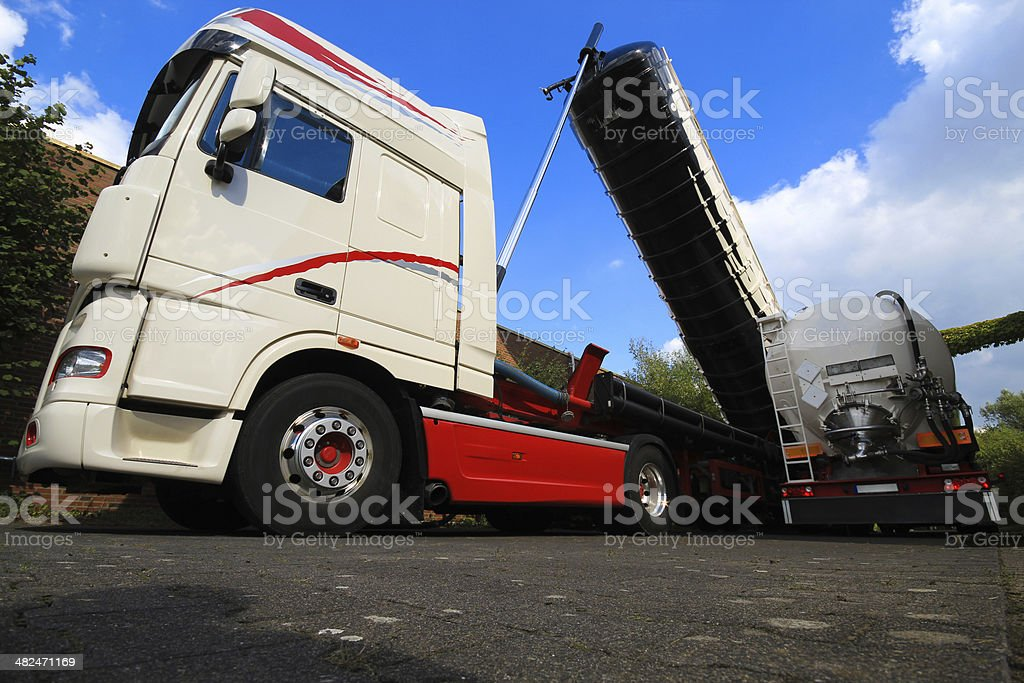 Road tanker is uploading activated carbon stock photo