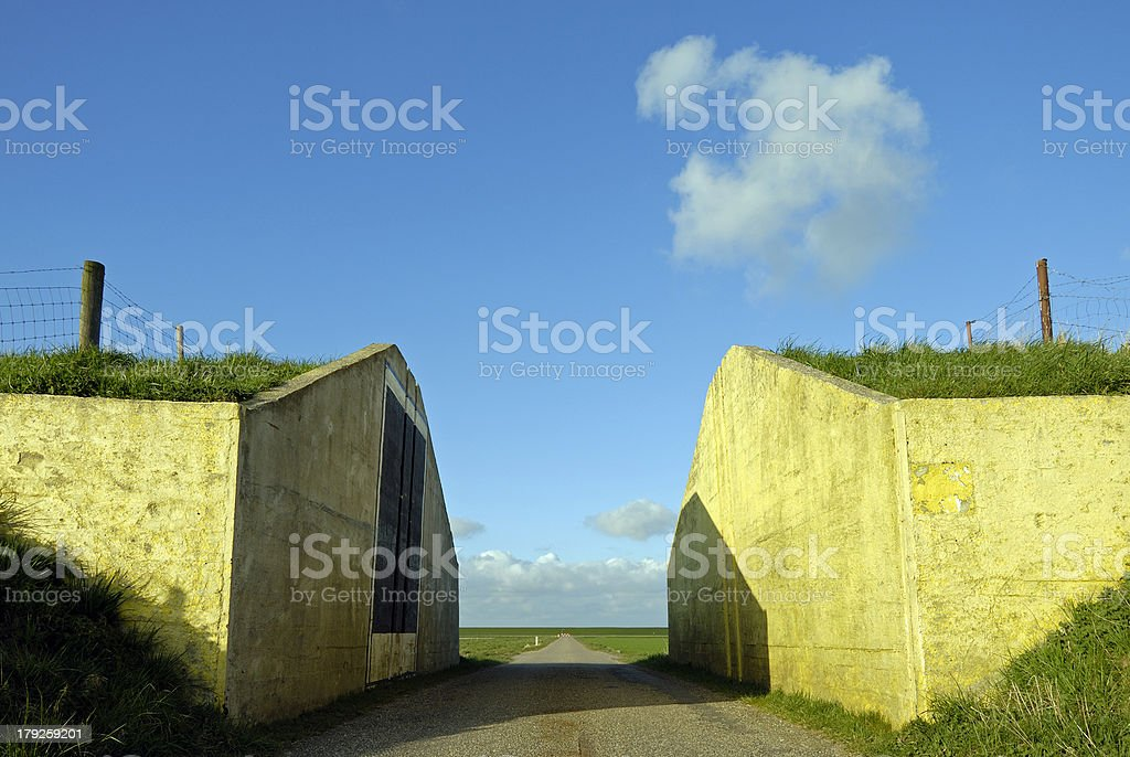 road through a dike royalty-free stock photo