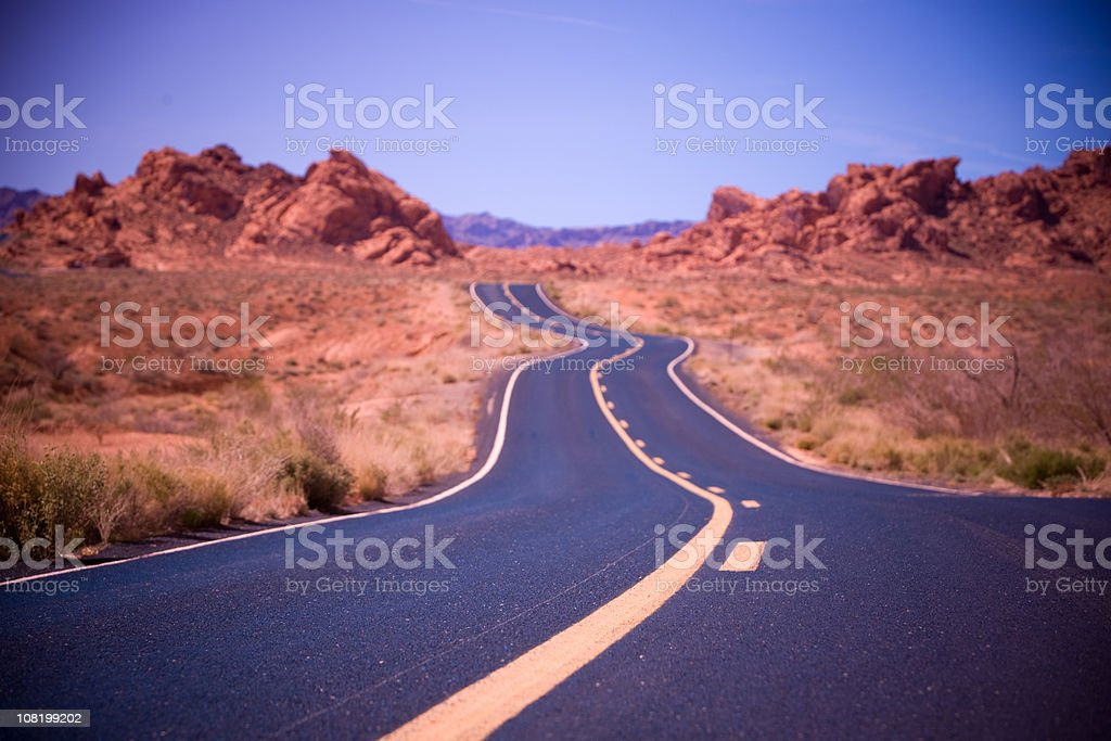 Road Through Desert Landscape stock photo
