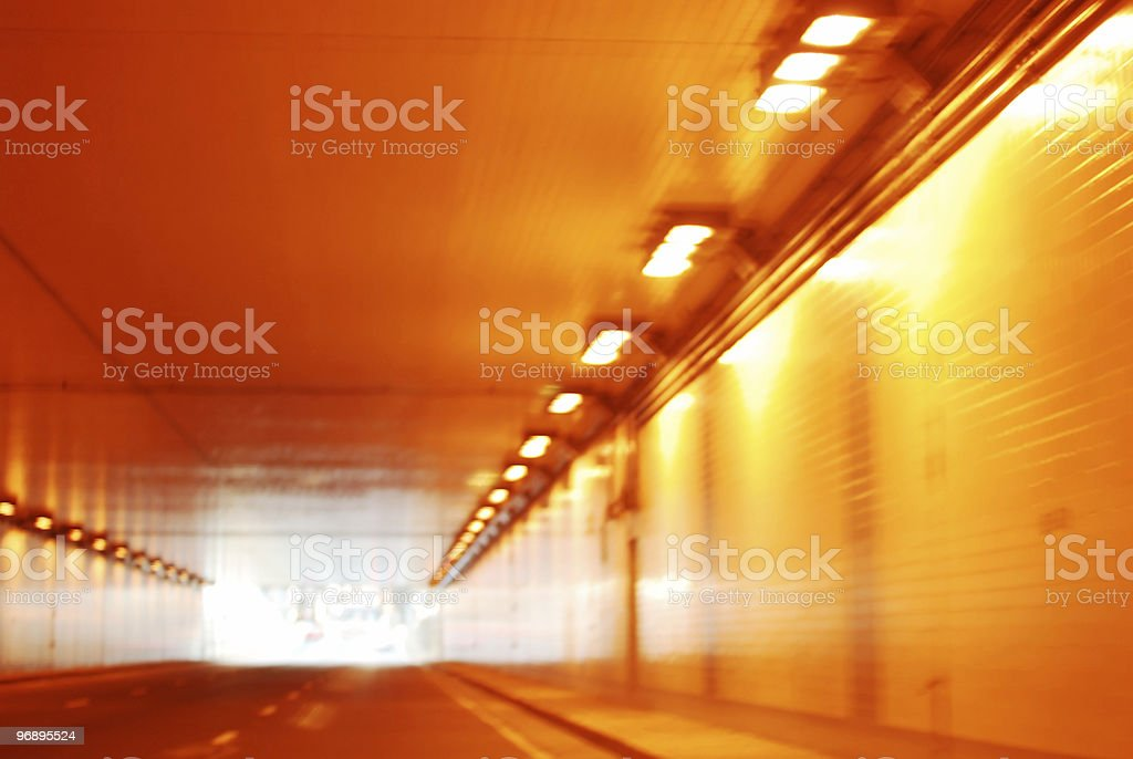 Road through illuminated glowing tunnel royalty-free stock photo