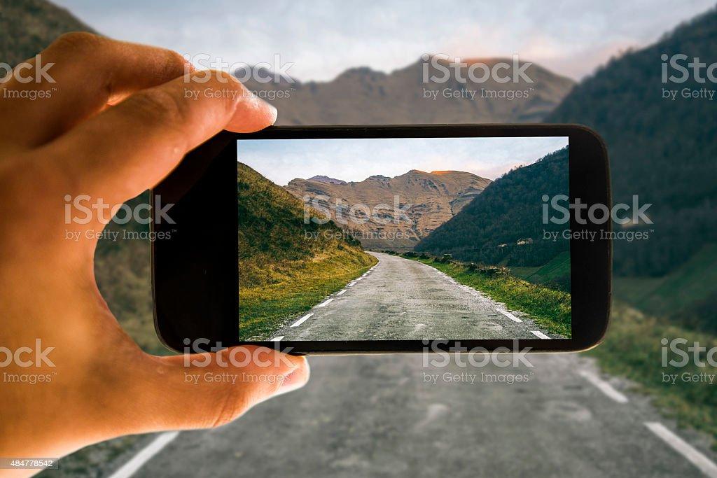 Road through mobile phone screen stock photo