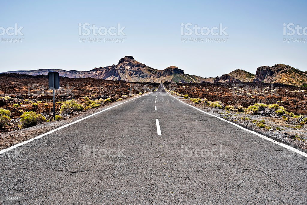 Road through old lava field in Teide National Park stock photo