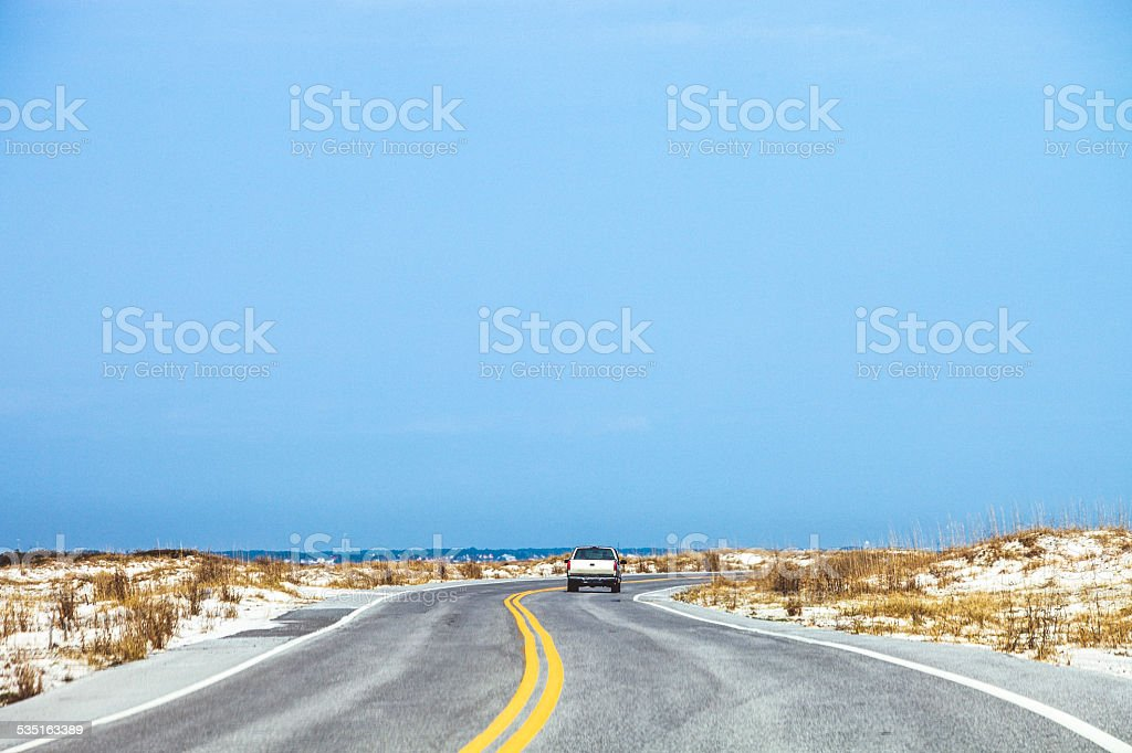 Road through sand dunes. stock photo