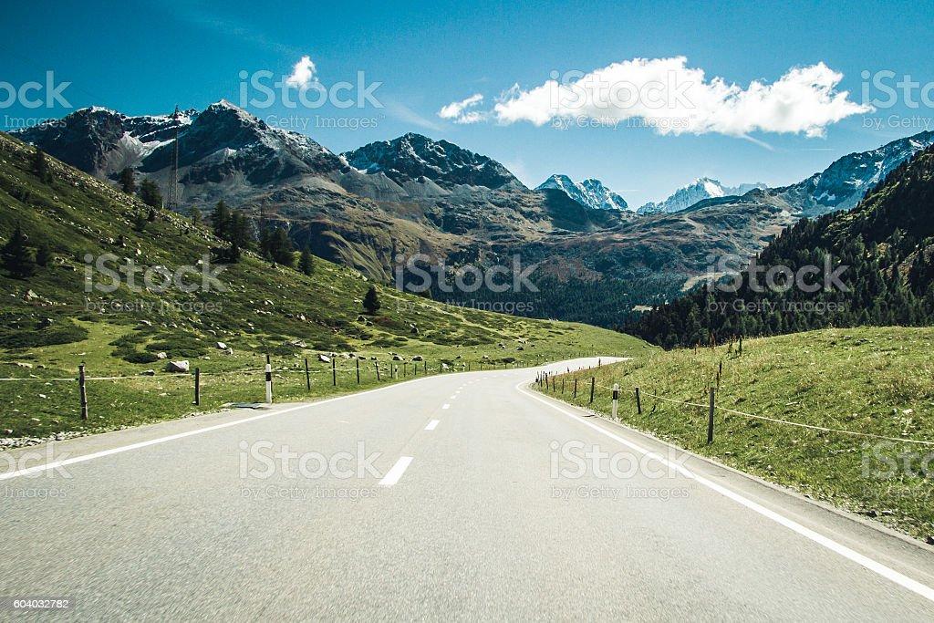 Road through swiss Alps. stock photo