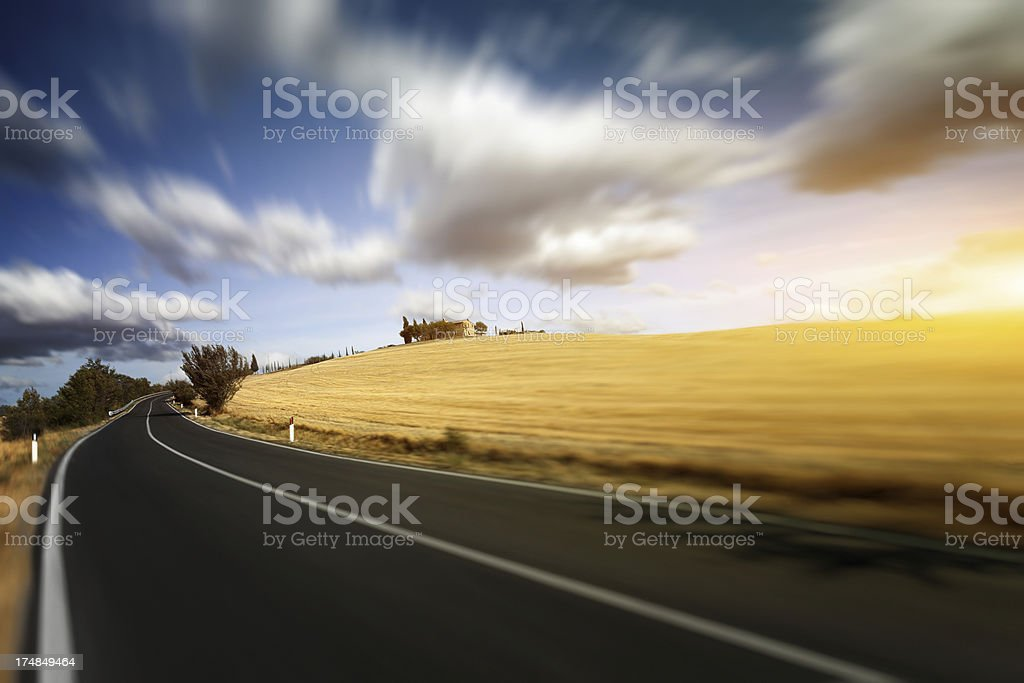 Road through the fields of Tuscany royalty-free stock photo